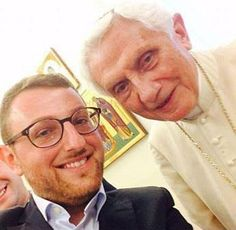 Retired Pope Benedict XVI poses for what is said to be his first selfie Sept. 12 with Italian seminarian Giuseppe Ricciardi.