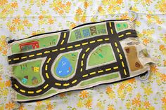 kid's backpack opens to become a playmat for cars... very cool!