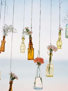 Hanging Vases With Flowers | Angga Permana Photo on @polkadotbride via @aislesociety