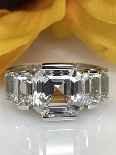 Asscher Cut White Sapphire Engagement Ring With Emerald Cut Accents In White Gold by InfinityJewelersUSA on Etsy Sparkly Jewelry, White Gold Jewelry, Diamond Jewelry, Jewelry Rings, Body Jewelry, Round Diamond Ring, Diamond Bands, Fashion Rings, Ring Designs