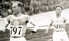 Paavo Nurmi wins the 10,000m at the 1928 Olympics, comfortably ahead of his compatriot Ville Ritola. Photograph: Popperfoto/PPP