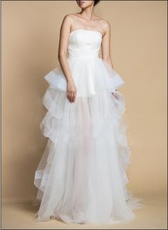 Stylish layered wedding gown with cascades of bridal tulle
