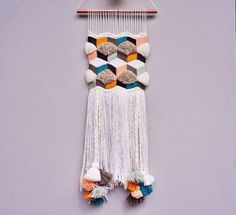 1 medium size handmade weaving wall hanging made from high quality yarns. Dimensions are approximately 22cm wide by 70cm long Item is
