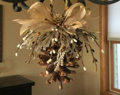 25 unique Rustic christmas ornaments DIY this using a glue gun, wired ribbon, and faux berries and foliage.Pinecone ornament natural pinecones nature crafts by huge pinecones 7 feet of ribbon twine Silver faux branches white faux berries red Christmas Pine Cones, Rustic Christmas Ornaments, Pinecone Ornaments, Handmade Ornaments, Pinecone Christmas Crafts, Pinecone Decor, Ornaments Ideas, Christmas Tree, Christmas Vacation