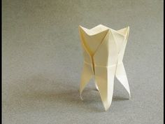 A great present for your Dentist! This origami tooth is Marc Kirschenbaum's creation. Read more here: http://www.origamispirit.com/2011/09/a-gift-for-your-dentist/