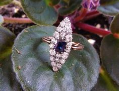 Elongated Victorian Era Old Mine cut diamond and sapphire ring set in 14K yellow gold with 1.40 carats total weight in diamonds surrounding a 0.80 carat sapphire.
