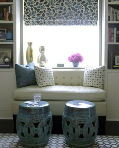 One way to turn a window seat into something more substantial is to add a coffee or cocktail table where one can set down a cup of tea.