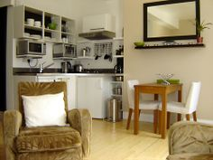 Central furnished London apartment for A gem in gentrified Fitzrovia steps from Marylebone. Lovely Apartments, Cosy Bedroom, London Apartment, Kitchen Corner, Covent Garden, Martini, Gem, Bookcase, Shelves
