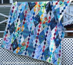 I spent most of the holiday weekend sewing the binding on the Blu diamond quilt. I took beauty shots of the quilt hanging from my neighbor. Scrappy Quilts, Easy Quilts, Mini Quilts, American Quilt, String Quilts, Hexagon Quilt, Custom Quilts, Diamond Quilt, Quilt Making