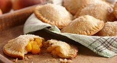 Ginger Peach Mini Pies: Hand-held fruit pies are the latest dessert craze. These mini versions of the traditional pie come in a variety of shapes and feature a flaky crust and sweet fruit...