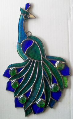 Peacock in glass Stained Glass Ornaments, Making Stained Glass, Stained Glass Birds, Stained Glass Christmas, Stained Glass Suncatchers, Stained Glass Panels, Stained Glass Projects, Stained Glass Patterns Free, Stained Glass Designs