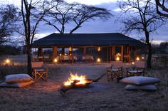 Enjoy sun-downers by the fire in the Northern #Serengeti with http://www.jpsluxurysafaris.com/