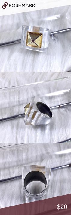 Vintage Clear Lucite & Brass Pyramid Stud Ring Sz 7 Brushed clear Lucite with silver underlay with brass pyramid stud in center thick band. Stud has some wear due to age. Mixed metal alloys. Punk gothic retro bohemian boho glam. Comes with dust bag. Only 1 available. High end costume jewelry. Source is Estate vintage jewelry. 🌟 Save the most with bundles. I offer 25% OFF on bundles of 2+ items. I accept reasonable offers on single items & bundles. NO trades/holds/lowball offers. Boutique…