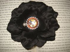 The Hunger Games Flower Hair ClipCatching by Emmandjensflowers, $8.00