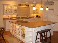 Beadboard cabinet with Quartz counter top.