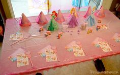 I like the idea of a princess and palace pets party, might be a bit easier, can reuse some party supplies...also like the idea of using the party favours as party decorations (displayed in jars), good way to be cost-effective