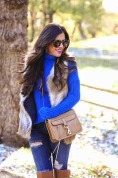 Combine my bright blue sweater with fur vest