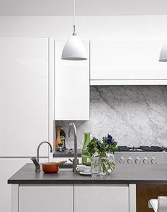 Modern white kitchen with marble splash back