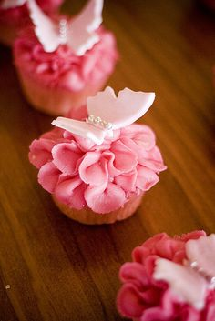Pink Butterfly CupCakes love the way the frosting looks like a flower:)