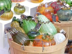 Some of the crafts available at the Half Moon Bay Art & Pumpkin Festival include glass pumpkins of every size and shape.