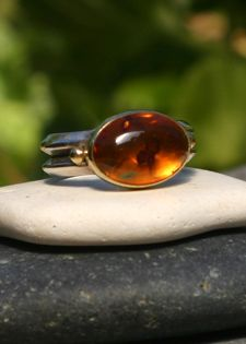 Large, brilliant Russian Amber cabochon set in 18k gold and sterling silver.