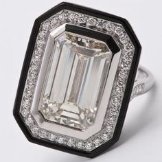 Art Deco Emerald Cut Ring // I actually think this is a really cool / striking cocktail ring - very unique!