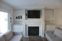 building a fireplace built in with cabinets and shelving - via the sweetest digs