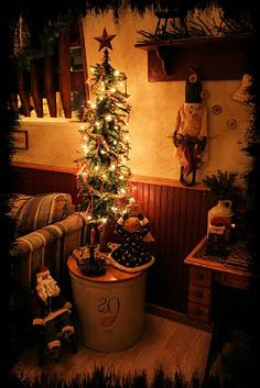 neat decorated tree sitting on a gorgeous crock with wooden lid  Love that crock !