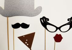 Perfect for a New Year's Party:    Raise a glass and toast to wonderful adventures ahead!    For the Gent:  One silver glitter derby bowler hat  One mustache    For the Lady:  One pair of black ulta chic pair of glasses  One kissable pair of red lips    And for the Party:  One glittery gold glass of bubbly.