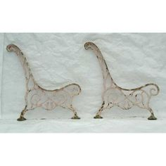 Antique French cast iron bench ends.