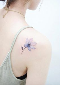 Beautiful bluish back shoulder tattoo by Banul