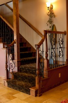Stair Systems | staircase with wrought iron balusters and alder handrail | Bayer Built Woodworks