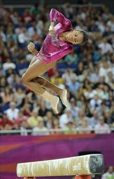 American gymnast Gabrielle Douglas competes in the Olympic all-around.