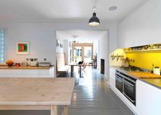 Kilburn Nightingale remodels Hackney townhouse with sweet-chestnut