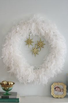 DIY feather wreath (Easy to make and looks gorgeous above a mantel.)