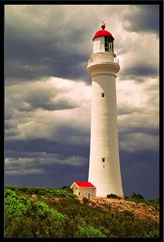 aireys inlet lighthouse storm in Victoria, Australia, by Barry Feldman Lighthouse Storm, Lighthouse Art, Lighthouse Pictures, Beacon Of Light, Victoria Australia, Vic Australia, Light Of The World, Australia Travel, Beautiful Places