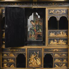 A Chinoiserie gilt and black japanned cabinet-on-stand, late 19th/early 20th century in the form of a pagoda, with two frieze drawers above cupboard doors opening to reveal an arrangement drawers, secret compartments and pigeon-holes around a central cupboard door, the reverse with a hidden cupboard, on a giltwood stand