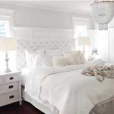 All white bedroom.