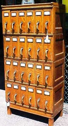 """Oak File Cabinet - QUARTER CUT OAK 24 DRAWER FILE CABINET. Four sections plus top & base. Made by the Office Specialty Mfg. Co. Ltd. Toronto. Circa 1930's. Each drawer held an account file box.Total height of unit is 68 1/2"""" tall X 33"""" wide X 18"""" deep."""
