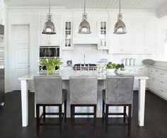 """classic white kitchen with marble/polished nickel details.  Lights are """"Benson"""" by Restoration Hardware."""
