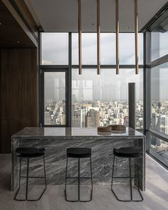 Awesome city views from this minimal interior worth wall of windows