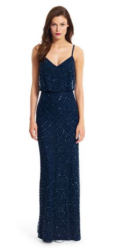 A scalloped pattern of sparkling beads cascade down this beautiful gown, featuring a flattering blouson silhouette.