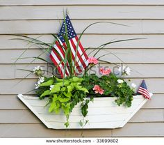 boat planter with flowers and american flags - stock photo Herb Garden, Garden Art, How To Fold Towels, Flower Pots, Flowers, Beach Crafts, Window Boxes, Diy Garden Decor, Geraniums