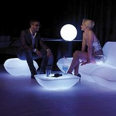 The Illuminated Pillow Outdoor Collection  The striking contemporary design of the illuminated Pillow Collection will be the centerpiece of any outdoor setting.    The LED illumination can display white, red, green, blue, light blue, pink or yellow. The finish is white when not lighted. Uses 120V current and each piece comes with a 10' cord. Remote control is included.