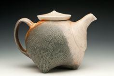 Soda fired teapot on feet