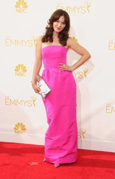 Emmys 2014 Red Carpet Dresses | POPSUGAR Style & Trends Zooey Deschanel heated things up in Oscar de la Renta's hot pink gown and sleek silver accessories.