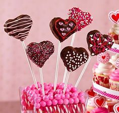 Valentines Brownie Pops: Bake your favorite brownie recipe, cut out heart shapes, insert a cookie stick then dip in chocolate candy melts that have been heated in a chocolate melting pot. Decorate with sprinkles, melted chocolate drizzle and icing, then arrange in a cute container filled with candy sticks and gumballs for a brownie bouquet.