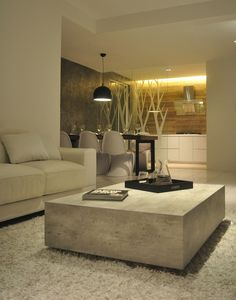 Stone minimalist design table for a modern interior #minimalistcoffeetable luxury design #modernlivingroom the living room #livingroomdesign . See more at www.coffeeandsidetables.com