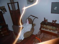 This photo was taken in the Galion Historical Museum located inside the Brownella Cottage Carriage Houser. There is no glass in front of the displays, but this picture has a strange light anomaly, which is not duplicated in the pictures taken after.