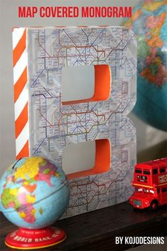 KoJo Designs: create a map covered monogram. Would be neat to make one for every place you have been. Big Boy Bedrooms, Baby Boy Rooms, Transportation Room, Room London, Toddler Rooms, Kids Rooms, Diy Projects For Kids, Toy Rooms, Room Themes